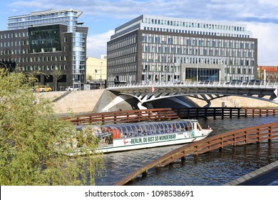 Berlin, Federal Republic of Germany - April 27, 2018: A river cruise ship on the River Spree against the backdrop of the Federal Press Conference e.V.