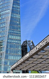 Berlin, Federal Republic of Germany - April 27, 2018: Entrance to Potsdamer Platz station in the background of modern buildings on Potsdamer Platz.