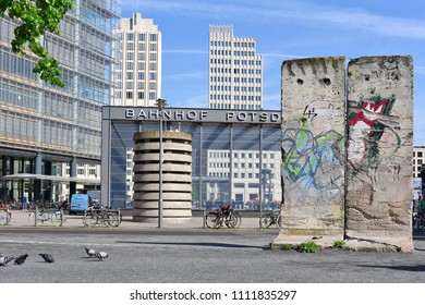 Berlin, Federal Republic of Germany - April 27, 2018: Concrete structures of the Berlin Wall on Potsdamer Platz at the entrance to Potsdamer Platz station.