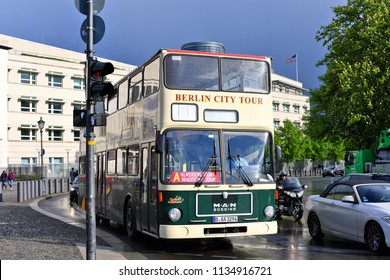 Berlin, Federal Republic of Germany - April 27, 2018: Excursion double-decker bus for a sightseeing trip on  the city street.