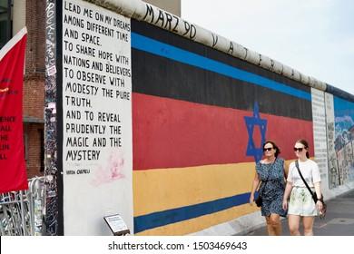 Berlin, Friedrichshain / Germany - September 2019: Combined Jewish/Israel and German flag on Berlin wall
