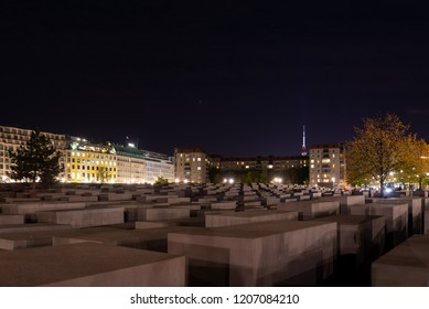 BERLIN, GERMANY, 03 DEC 2018: Night view at the Memorial to the Murdered Jews of Europe, Holocaust memorial which consisted of 2,711 concrete cubes and underground exhibition in Berlin, Germany.