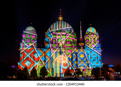 Berlin, Germany - 06 OCTOBER 2018: Night atmosphere of Festival of Lights, Berlin leuchtet, the projection mapping lighting art at Berliner Dom, Berlin Cathedral, during the night on German Unity Day.