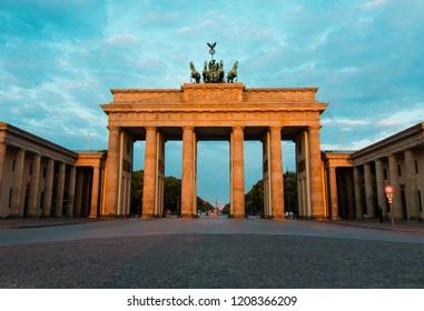 Berlin, Germany - 06.09.2018. Famous Brandenburger Tor (Brandenburg Gate) in beautiful golden morning light at sunrise.