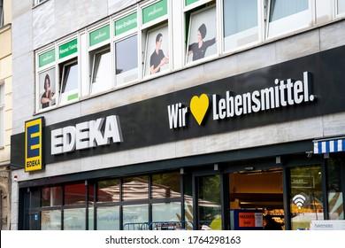 Berlin, Germany, 06/11/2020: Logo on the facade of an Edeka store in Berlin with text: Wir lieben Lebensmittel (engl.: we love foot)