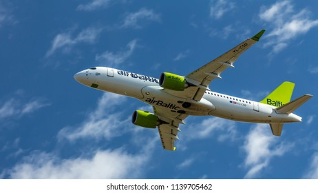 Berlin, Germany, 07.07.2018: Air Baltic Bombardier C5300 aircraft flying in the sky, Tegel Airport