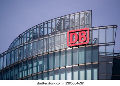 "Berlin, Germany - 08. October 2019: The logo of the German railway company ""Deutsche Bahn AG"" on the BahnTower, the headquarter of Deutsche Bahn, in Berlin."