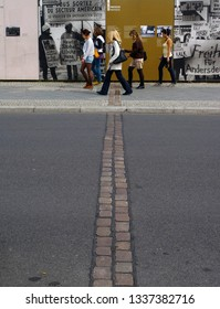 Berlin - Berlin - Germany - 08-12-2011 - Pedestrians crossing the line that marks the place where the Berlin Wall once stood