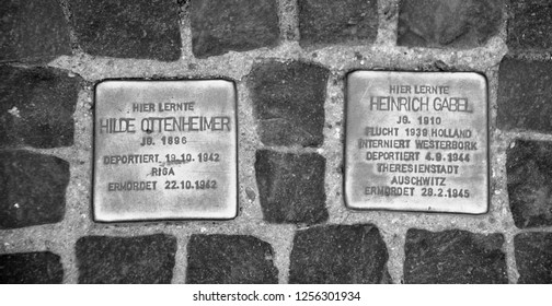 BERLIN GERMANY 09 22 17: A stolperstein stumbling stone or stumbling block is a cobblestone concrete cube bearing a brass plate inscribed with the name of victims of Nazi extermination or persecution.