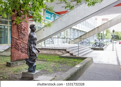 Berlin, Germany 09/10/2019 Statue of revolutionary socialist Rosa Luxemburg by Rolf Biebl stands outside the headquarters of the Rosa Luxemburg Foundation in the publishing building Neues Deutschland