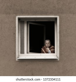 Berlin, Germany - 10 Oct 2018: Unidentified old woman staring out the window in her retirement residence