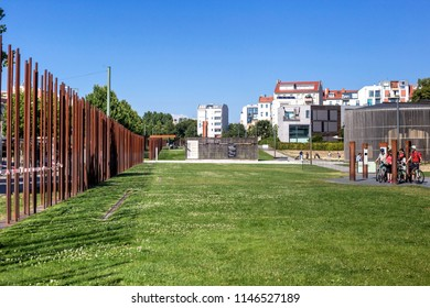BERLIN, GERMANY - 14 Jul 2018: The Berlin Wall Memorial on Bernauer Strasse, represents the former border strip and contains the last piece of Berlin Wall with the preserved grounds behind it