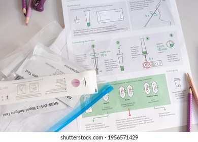 Berlin, Germany - 14-04-2021: SARS-Cov-S Rapid Antigen Test, self test for school children with school equipment on desk