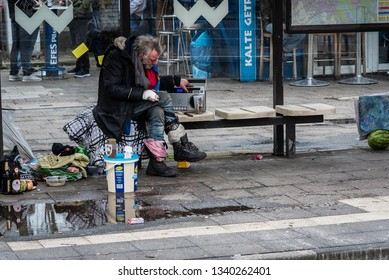 Berlin, Germany - 15.03.2019 Homless Man sitting in a Tram Station, listening to radio, tram station, homless