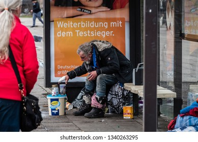 Berlin, Germany - 15.03.2019 Homless Man sitting in a Tram Station, listening to radio, tram station, homless, Berlin City