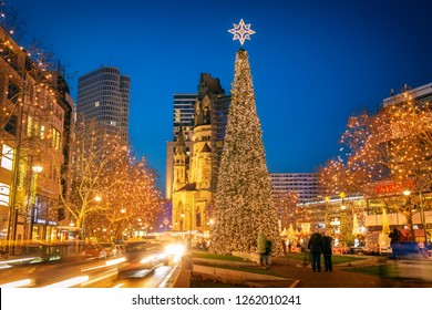 BERLIN, GERMANY - 16 Dec 2018: Illuminated Tauentzienstrasse and a high decorated Christmas tree during Christmas time at Kudamm