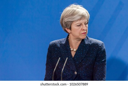 Berlin, Germany. 16th February, 2018: Theresa May at the german chancellery  (press conference) listening to what Angela Merkel is saying