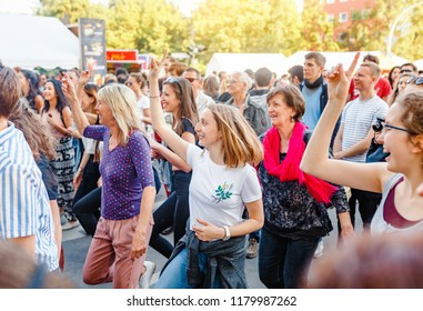 BERLIN, GERMANY - 20 MAY 2018: dance flash mob at the Festival of Cultures in Berlin. People dancing lindy hop outdoors at city street