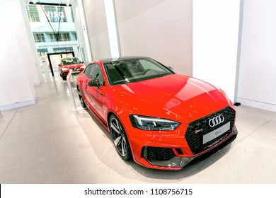 Berlin, Germany, 2018 - Audi RS5 Quattro Coupe (2018) in red, in a showroom - VW DRIVE 70 years of Porsche Sports Car