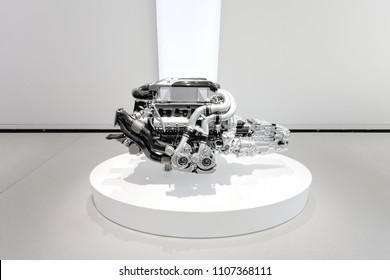Berlin, Germany, 2018 - Bugatti Chiron Engine, 16 Cylinder, 1500 hp, 8 litre, W16 - Isolated in a showroom - VW DRIVE Exhibition 70 Years of Porsche Sportscars