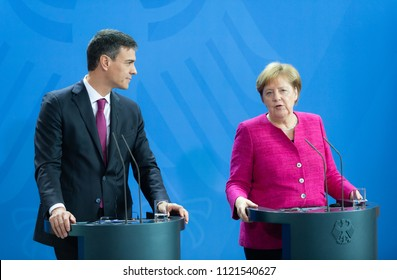 Berlin, Germany, 2018-06-26: German Chancellor Angela Merkel and the Prime Minister of Spain, Pedro Sanchez answering questions during the press conference at the federal chancellery in Berlin
