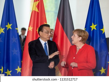 Berlin, Germany, 2018-07-09: German Chancellor Angela Merkel and the Prime Minister of China, Li Keqiang talk to each other during a signing ceremony at the Chancellery in Berlin
