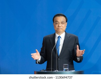 Berlin, Germany, 2018-07-09: The Prime Minister of China, Li Keqiang answers  questions at the press conference  at the federal chancellery in Berlin