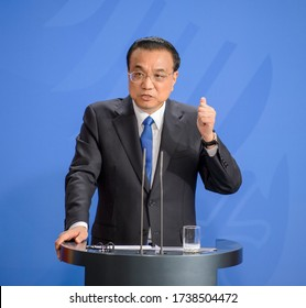 Berlin, Germany, 2018-07-09: The Prime Minister from China, Li Keqiang answers questions at the press conference  at the federal chancellery in Berlin