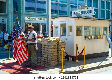 Berlin / Germany - 2018/07/30: Contemporary memorial of Checkpoint Charlie, known also as Checkpoint C - Berlin Wall crossing point between East and West districts during Cold War time