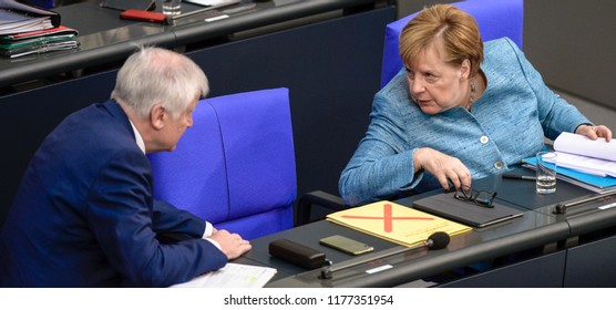 Berlin, Germany, 2018-09-11: German Chancellor Angela Merkel and German Minister of the Interoir, Horst Seehofer debate at the German Bundestag in Berlin