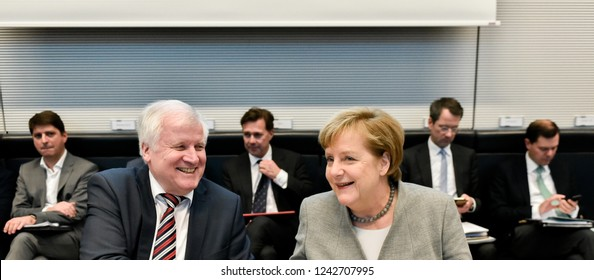 Berlin, Germany, 2018-11-27: German Chancellor Angela Merkel and Minister Horst Seehofer take part at the faction meeting of the conservative party at the German Bundestag