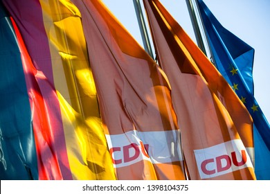 """Berlin, Germany - 2019 April 19: Orange Flag of the German Conservative Political Party """"CDU"""" (Christian Democratic Union Germany), together with the German and the European Union's Flag - Backlight"""