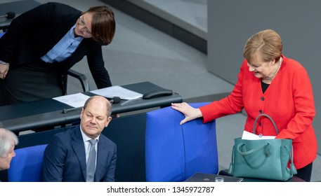 Berlin, Germany, 2019-03-21: German Chancellor Angela Merkel and Olaf Scholz, Minister for Finances arrive at the German Bundetag in Berlin to debate about Europe