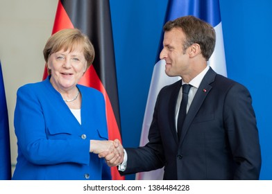 Berlin, Germany. 2019-04-29: Posing after the statements: German Chancellor Angela Merkel  and the French President Emmanuel Macron at the chancellery in Berlin