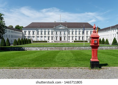 Berlin, Germany 2019-24-07: historic red fire alarm box, street alarm box, outside of Bellevue Palace in Berlin, Germany