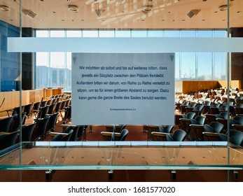 Berlin, Germany - 24 MARCH 2020: A sign referring to COVID-19 in the house of the Federal Press Conference (german: Bundespressekonferenz) the empty room, Germany