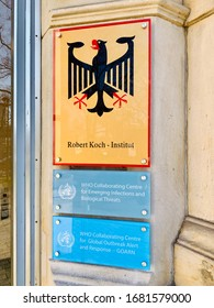 Berlin, Germany - 24 March 2020: Signs on the wall of the Robert Koch-Institut in Berlin.