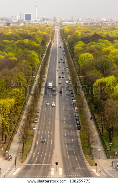 BERLIN, GERMANY - 26 APRIL, 2013. Aerial shot of  Strasse des 17. Juni, from the top of the Berlin Victory Column, in the Grosse Stern (Great Star), Grosser Tiergarten Park. Skyline in the background.