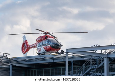 Berlin, Germany 26.02.2020: red helicopter on the roof of a accident hospital in berlin, the helicopter is prepared for ambulance and emergency services