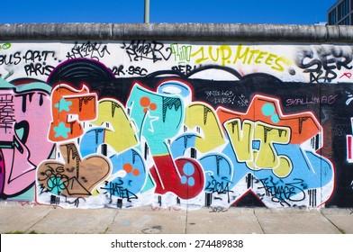 BERLIN, GERMANY - 30 April 2015: Graffiti on the Berliner Mauer, Friedrichshain. Berlin on April 30, 2015. Berlin, Germany