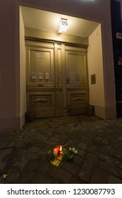 """Berlin, Germany (9th November 2018) - """"Stolpersteine"""" (literally """"stumbling stone"""") with the names of Jewish victims under Nazism adorned with roses and candles on the anniversary day of Kristallnacht"""