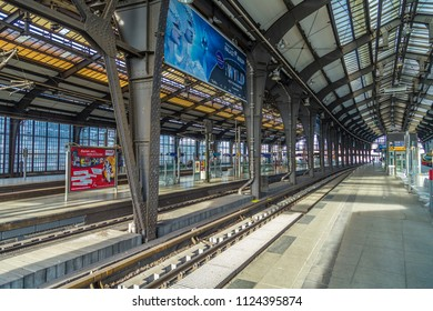 BERLIN, GERMANY - APR 1, 2016: people  at Berlins central s-Bahn station at Friedrichstrasse. It was the former entrance point with check point of the German democratic republic called DDR.