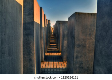BERLIN, GERMANY, APR 23 : Blocks at the Memorial to the Murdered Jews of Europe in Berlin, Germany, isolated on blue sky. Berlin, Gemrany, April 23, 2018