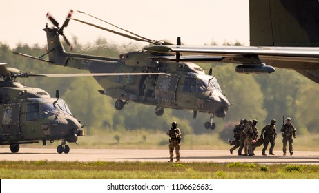 BERLIN, GERMANY - APR 27, 2018: German military NH90 troop helicopter and special forces performing a military demonstration at the Berlin ILA Air Show.