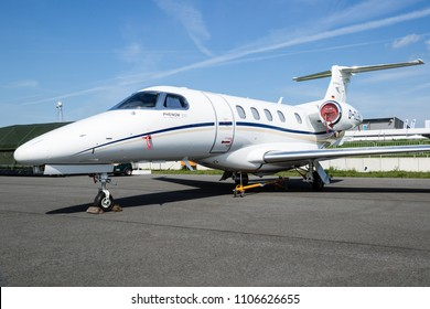 BERLIN, GERMANY - APR 27, 2018: Modern Embraer EMB-505 Phenom 300 light business jet on display at the Berlin ILA Air Show.