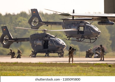 BERLIN, GERMANY - APR 27, 2018: German military Airbus H145M helicopters and special forces performing a military demonstration at the Berlin ILA Air Show.