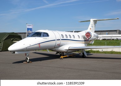 BERLIN, GERMANY - APR 27, 2018: Modern Embraer EMB-505 Phenom 300 light business jet showcased at the Berlin ILA Air Show.