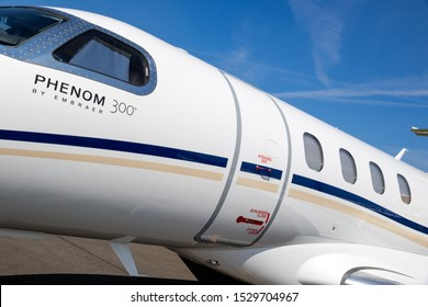 BERLIN, GERMANY - APR 27, 2018: Modern EEmbraer Phenom 300 light business jet plane on display at the Berlin ILA Air Show.