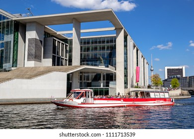 BERLIN, GERMANY - APR 28, 2018: Boat tour in front of the Marie-Elisabeth Luders Haus. One of the buildings in the new parliamentary complex in the new government quarter of Berlin.
