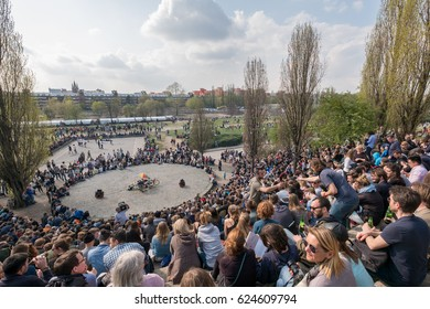 Berlin, Germany - april 02, 2017: People at Mauerpark watching the sundays Karaoke show in Berlin, Germany.